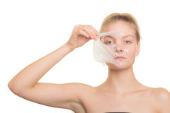Girl removing facial peel off mask Royalty Free Stock Images