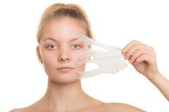 Girl removing facial peel off mask Stock Photos