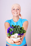 Girl after repair with flowers Royalty Free Stock Photography