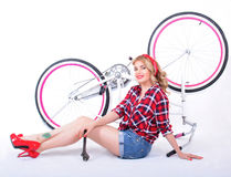 Girl repairing bike royalty free stock images