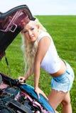 Girl repairing car Royalty Free Stock Photo
