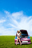 Girl repairing car Royalty Free Stock Image