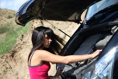 Girl repairing car Royalty Free Stock Photos