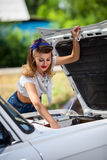 Girl repairing the car engine Royalty Free Stock Photo