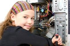Girl is repairing computer Stock Photo