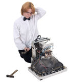 Girl repairing electronic equipment Stock Image