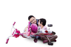 Girl repairing her bicycle with dad Stock Photo