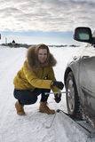 Girl repairing her car outside the city. Girl stopped on the road and your car repairs Stock Photo