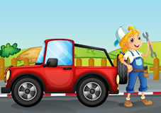 A girl repairing the red jeep Stock Image
