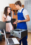 Girl and repairman fixing computer Royalty Free Stock Photo