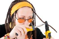 Girl repairs hairs Royalty Free Stock Image