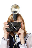 Girl reporter photographer with retro camera and flash Stock Photography