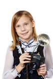 Girl reporter photographer with retro camera and flash Stock Photo