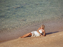 Girl reposes on beach Royalty Free Stock Image