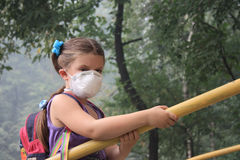 Girl in a respirator Royalty Free Stock Image