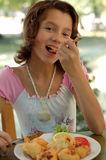 Girl in the restaurant. Young Girl Enjoying a cheese at a restaurant royalty free stock images