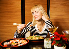 Girl in a restaurant Stock Image