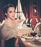Girl in a restaurant Stock Images