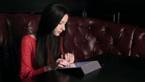 Girl In A Restaurant With A Tablet Royalty Free Stock Images