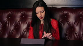 Girl In A Restaurant With A Tablet Stock Images