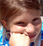 Girl resting 1. Close up of girl looking at you stock photography