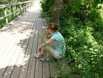Girl resting. A girl is resting after a long walk Stock Images