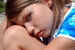 Girl resting 3. Girl resting on knee looking at you stock photo