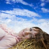 Girl resting against sky Royalty Free Stock Images