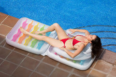 Girl resting in air mattress near pool Royalty Free Stock Image