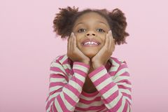 Girl Resting Chin In Hands Royalty Free Stock Photos