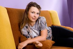 Girl resting on the couch Stock Photo