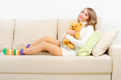 Girl resting on the couch Stock Photography