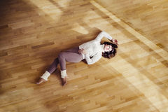Girl resting after the dance. The girl is lying and resting after a workout dance, the concept of sport & active leisure Stock Images