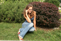Girl resting on grass Royalty Free Stock Photography