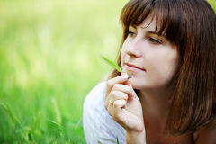 Girl resting in grass Stock Images