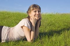 Girl resting on the grass Stock Photography