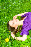 Girl resting on the grass Stock Images