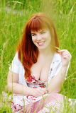 Girl resting in grass. Redhead sexy girl resting in grass Stock Photos