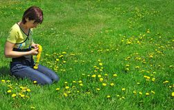 Girl resting on the green meadow Royalty Free Stock Images