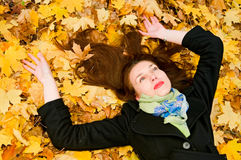 Girl resting on the ground Royalty Free Stock Image