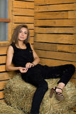 Girl resting on hay Stock Photo