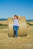 Girl resting on hay Stock Image