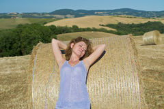 Girl resting on hay Stock Photos