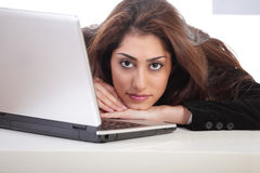 Girl resting head on laptop Stock Photo