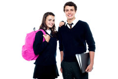 Girl resting her arm on classmates shoulder Royalty Free Stock Photos