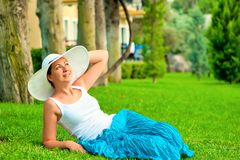 Girl resting on the lawn Royalty Free Stock Images