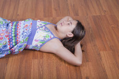Girl resting on the living room floor Royalty Free Stock Images