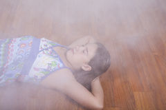 Girl resting on the living room floor Royalty Free Stock Photo