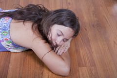 Girl resting on the living room floor Stock Photography