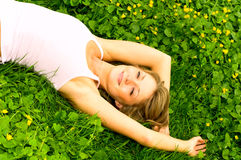 Girl resting on meadow Stock Photo
